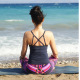 Woman sat meditating on beach